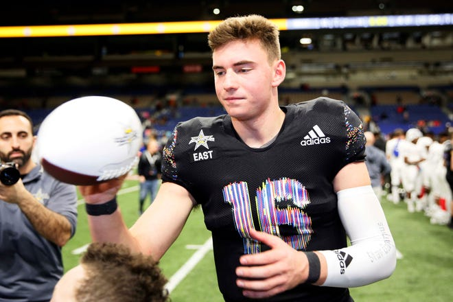 East quarterback Graham Mertz, a University of Wisconsin recruit, signs autographs after his standout performance in the U.S. Army All-American Bowl high school football game in San Antonio, Texas.