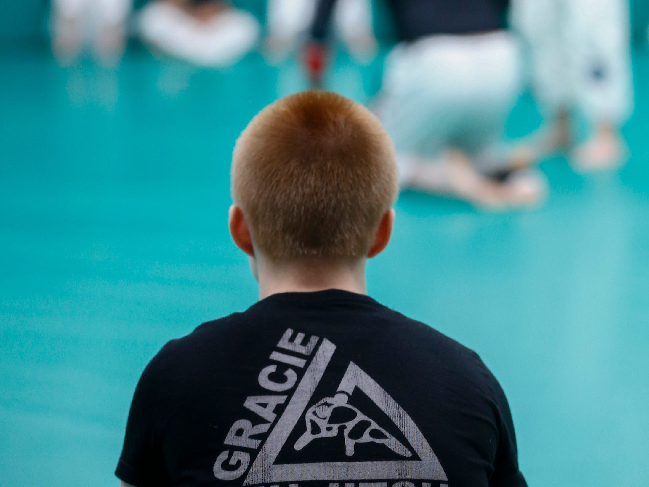 Twenty women and 12 students instructors gather during a self defense workshop for first-time students at Gracie Jiu-Jitsu Milwaukee in Wauwatosa on Jan. 5.