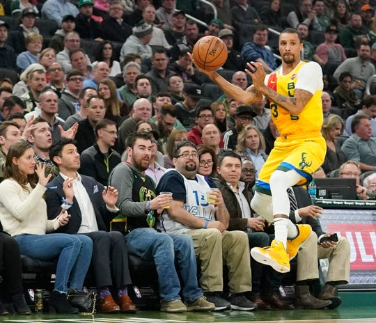 George Hill saves a ball from going out of bounds during a game in December.