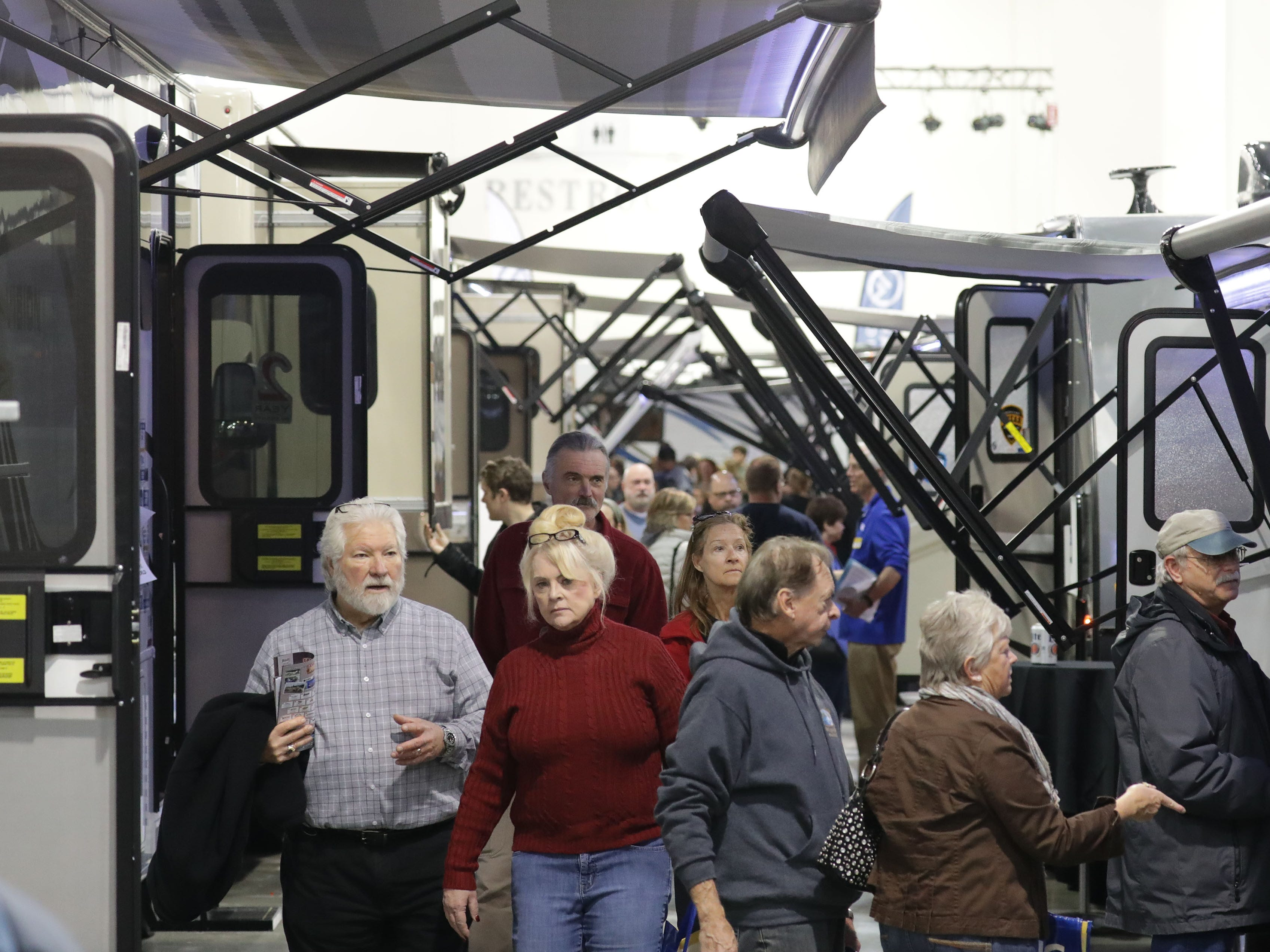 People check out the wide assortment of RVs during the 2019 Wisconsin RV Show at the Wisconsin Center in Milwaukee on Sunday.