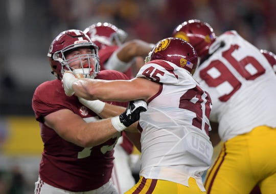 Sep 3, 2016; Arlington, TX, USA; Alabama Crimson Tide offensive lineman Jonah Williams (73) defends against USC Trojans defensive end Porter Gustin (45) during an NCAA football game at AT&T Stadium. Alabama defeated USC 52-6. Mandatory Credit: Kirby Lee-USA TODAY Sports