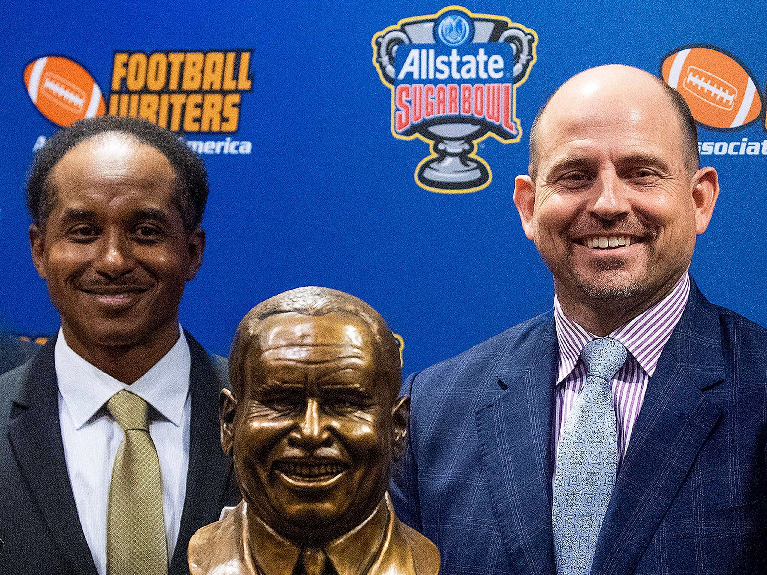 UAB football coach Bill Clark stands with Eddie Robinson, III, as he is presented the Eddie Robinson Coach of the Year Award during a ceremony in San Jose, Ca., on Saturday January 5, 2019.