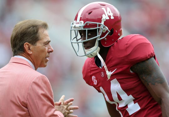 Apr 18, 2015; Tuscaloosa, AL, USA; Alabama Crimson Tide head coach Nick Saban talks to wide receiver Deionte Thompson (14) during the annual A-day game at Bryant Denny Stadium. Mandatory Credit: Marvin Gentry-USA TODAY Sports