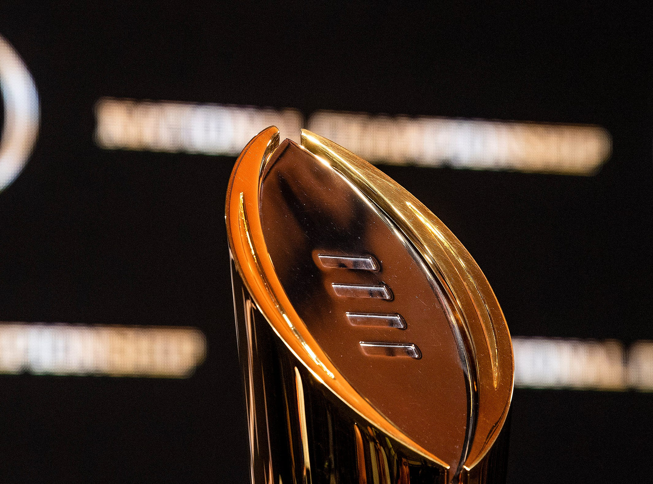 The National Championship Trophy is displayed during the College Football National Championship coaches press conference in San Jose, Ca., on Sunday January 6, 2019.