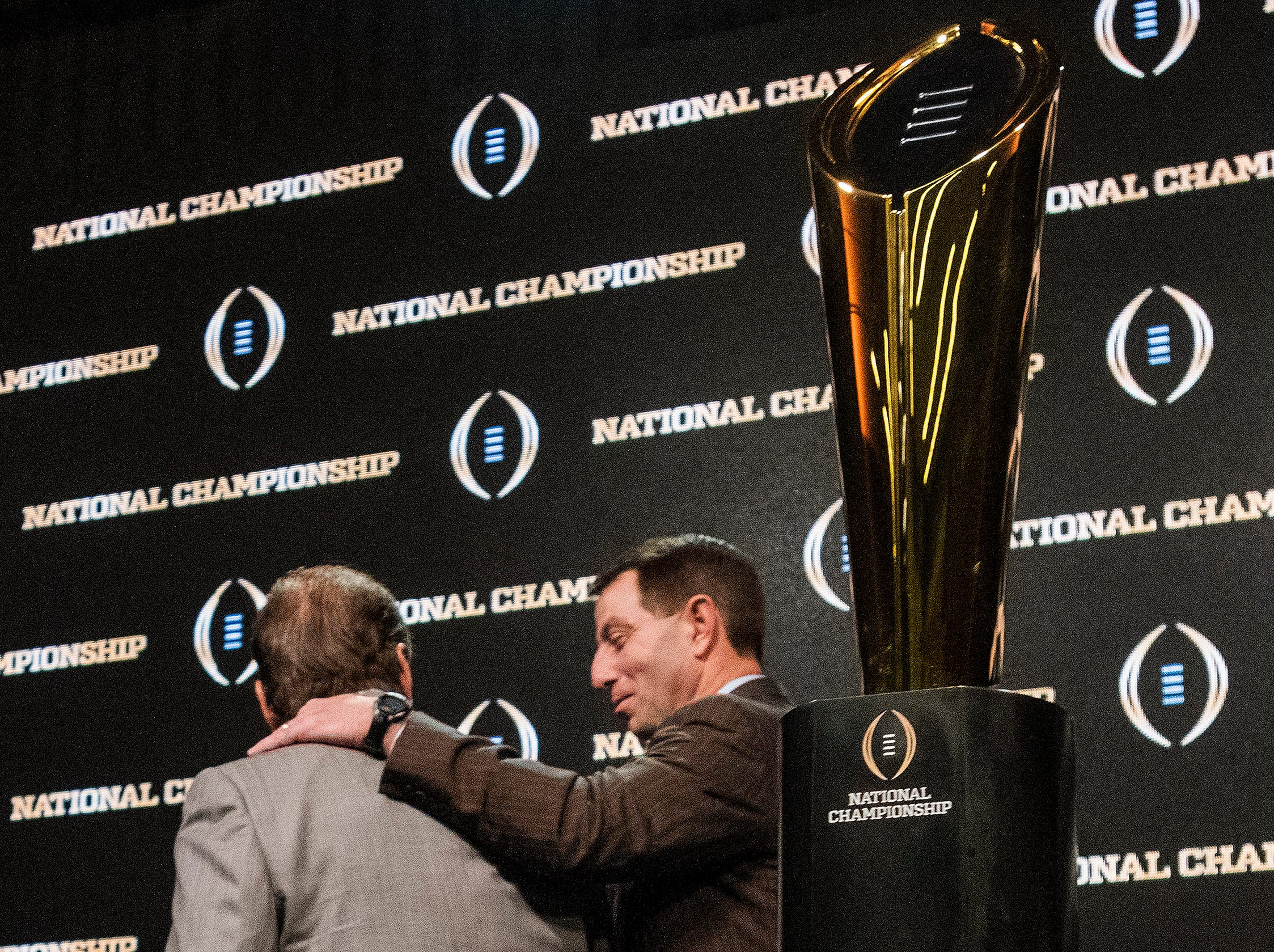 Alabama head coach Nick Saban and Clemson head coach Dabo Swinney  chat as they leave the College Football National Championship coaches press conference in San Jose, Ca., on Sunday January 6, 2019.