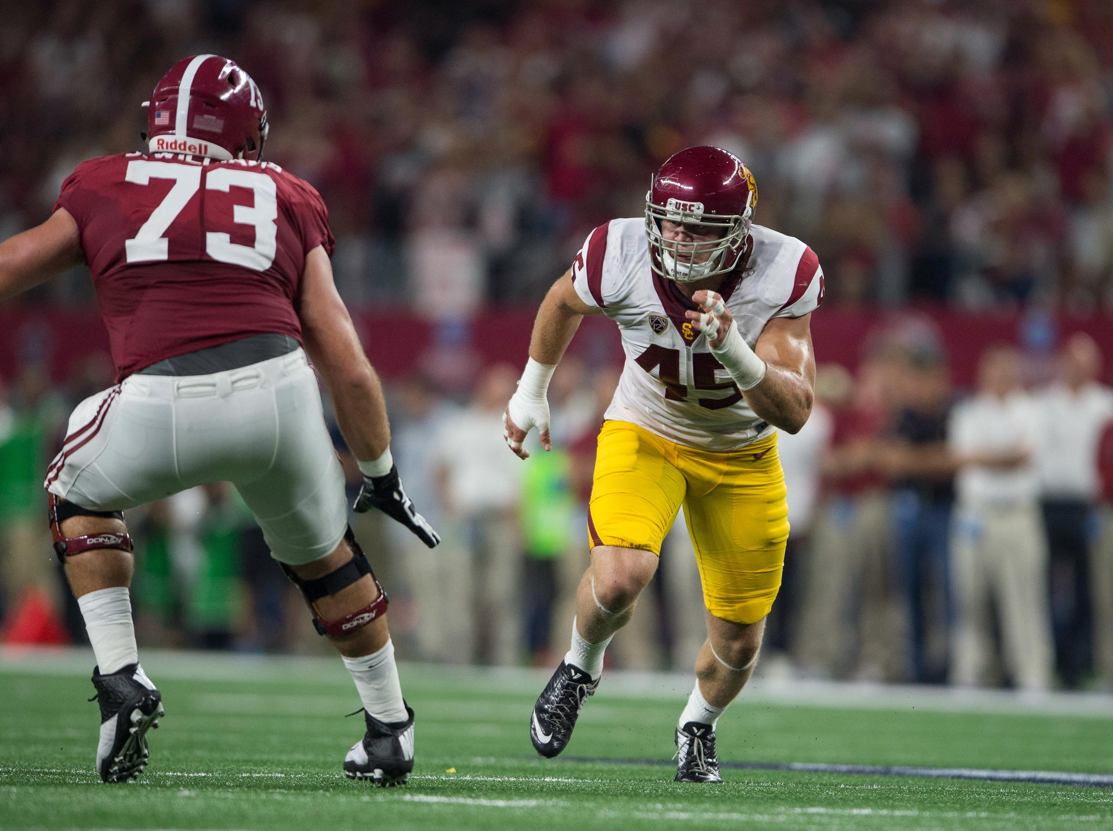 Sep 3, 2016; Arlington, TX, USA; Alabama Crimson Tide offensive lineman Jonah Williams (73) and USC Trojans defensive end Porter Gustin (45) in action during the game at AT&T Stadium. Alabama defeats USC 52-6. Mandatory Credit: Jerome Miron-USA TODAY Sports
