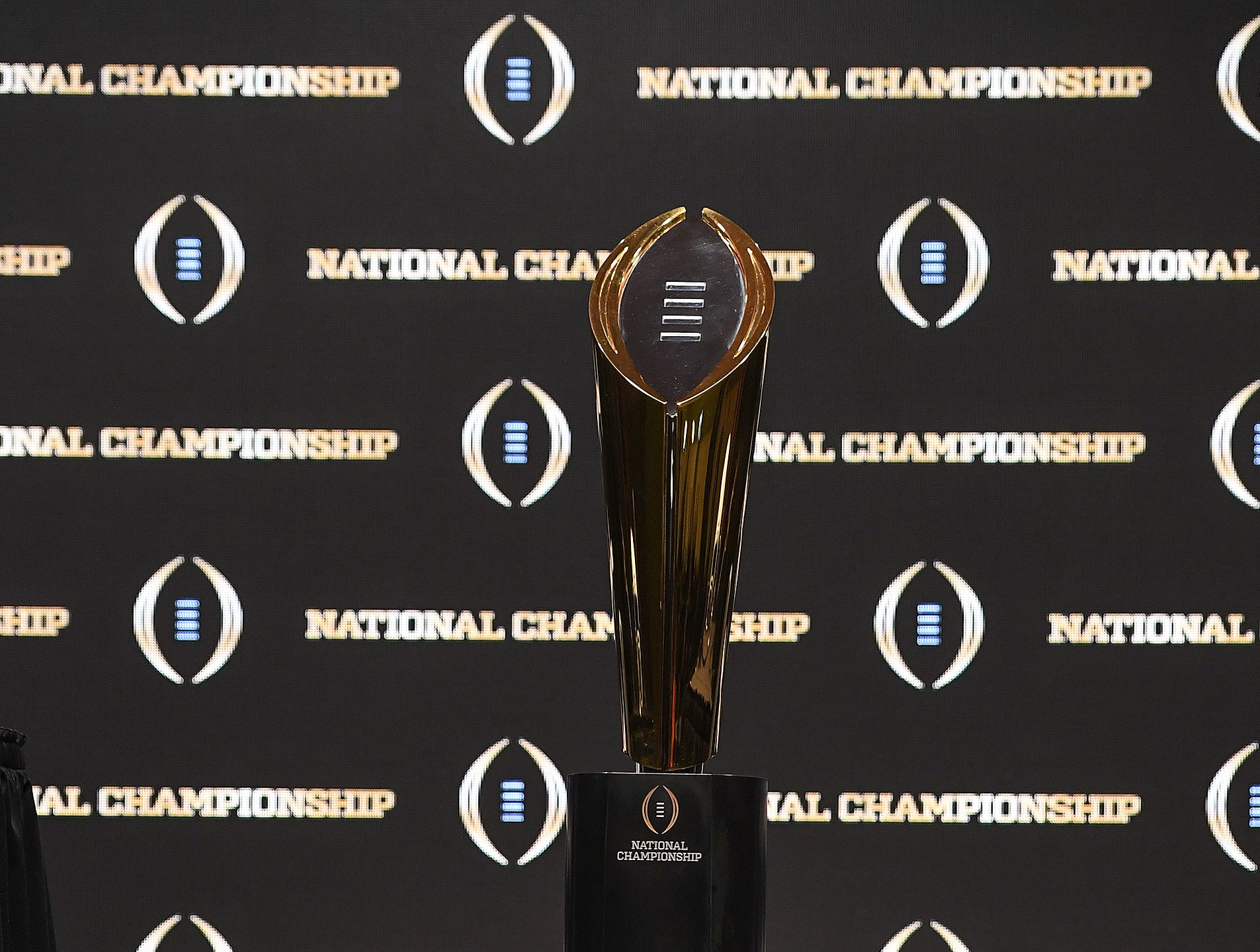 The College Football Playoff National Championship Trophy sits on the stage before the head coaches press conference in San Jose, California January 6, 2019.