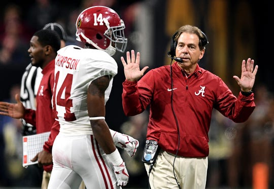 Jan 8, 2018; Atlanta, GA, USA; Alabama Crimson Tide head coach Nick Saban talks with Alabama Crimson Tide defensive back Deionte Thompson (14) during the second quarter in the 2018 CFP national championship college football game at Mercedes-Benz Stadium. Mandatory Credit: John David Mercer-USA TODAY Sports