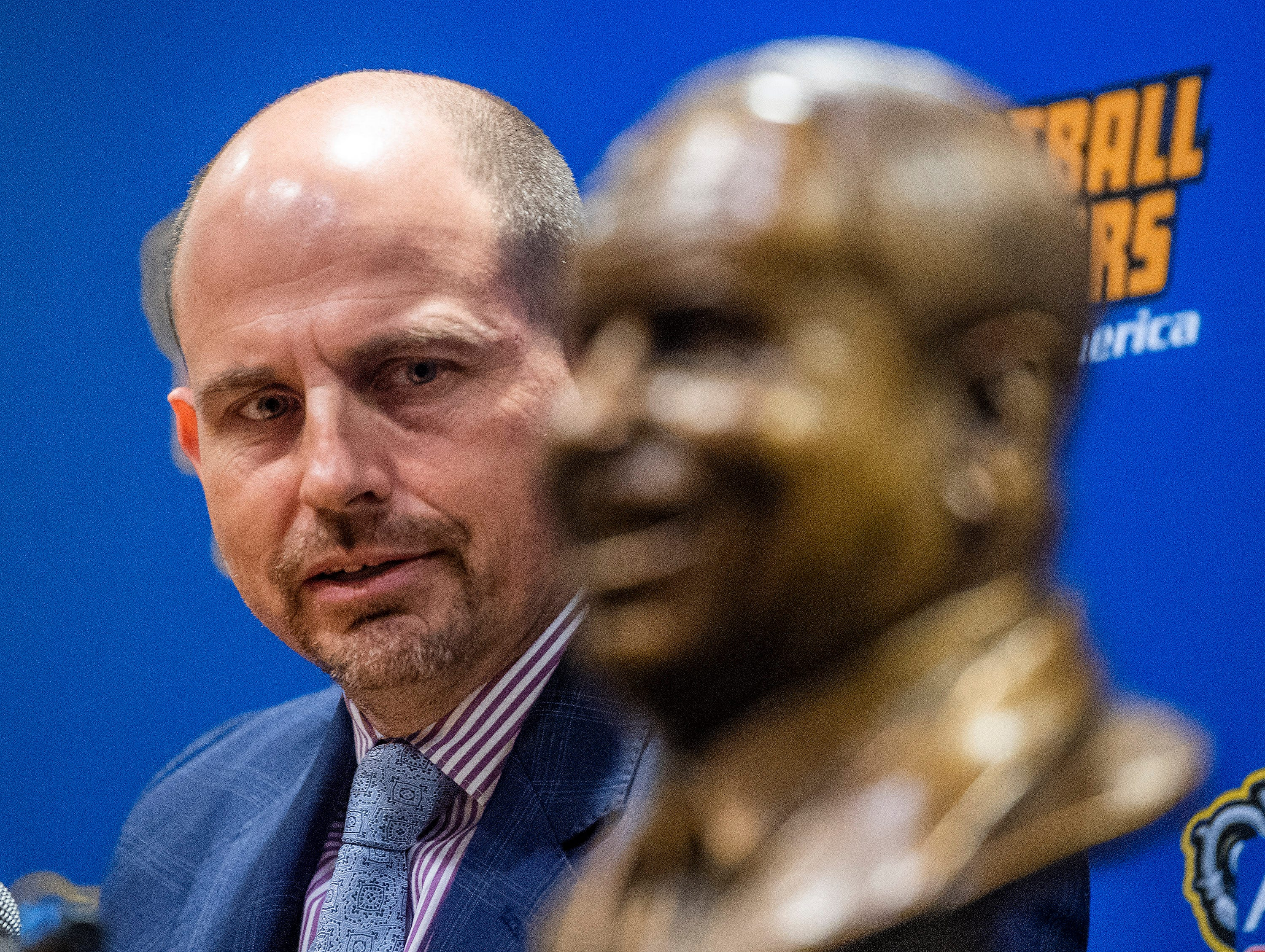 UAB football coach Bill Clark looks at the bust of Eddie Robinson as he responds to being presented the Eddie Robinson Coach of the Year Award during a ceremony in San Jose, Ca., on Saturday January 5, 2019.