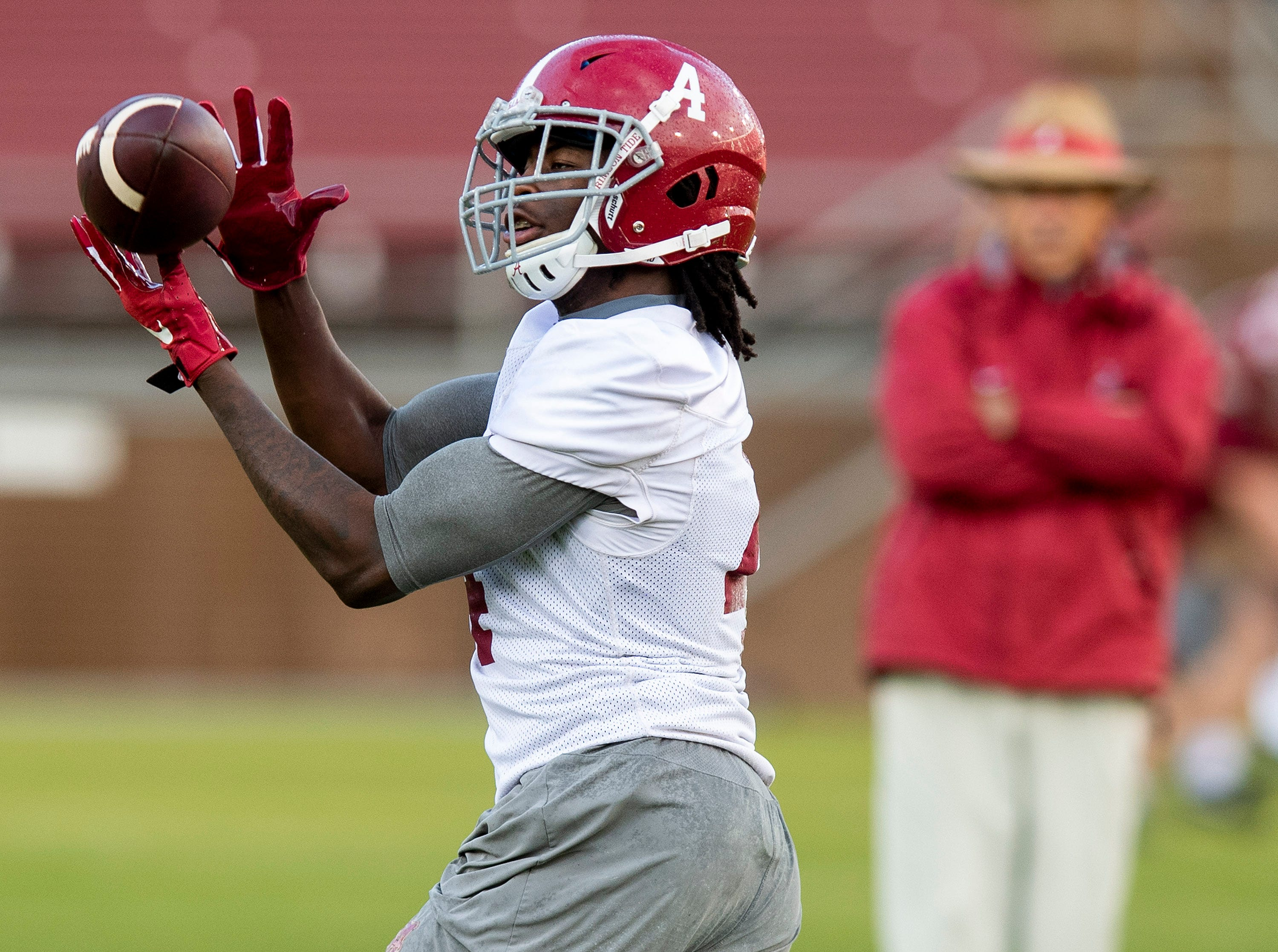 Alabama wide receiver Jerry Jeudy (4) catches a pass as Alabama practices on the Stanford campus in Stanford, Ca., on Saturday January 5, 2019.