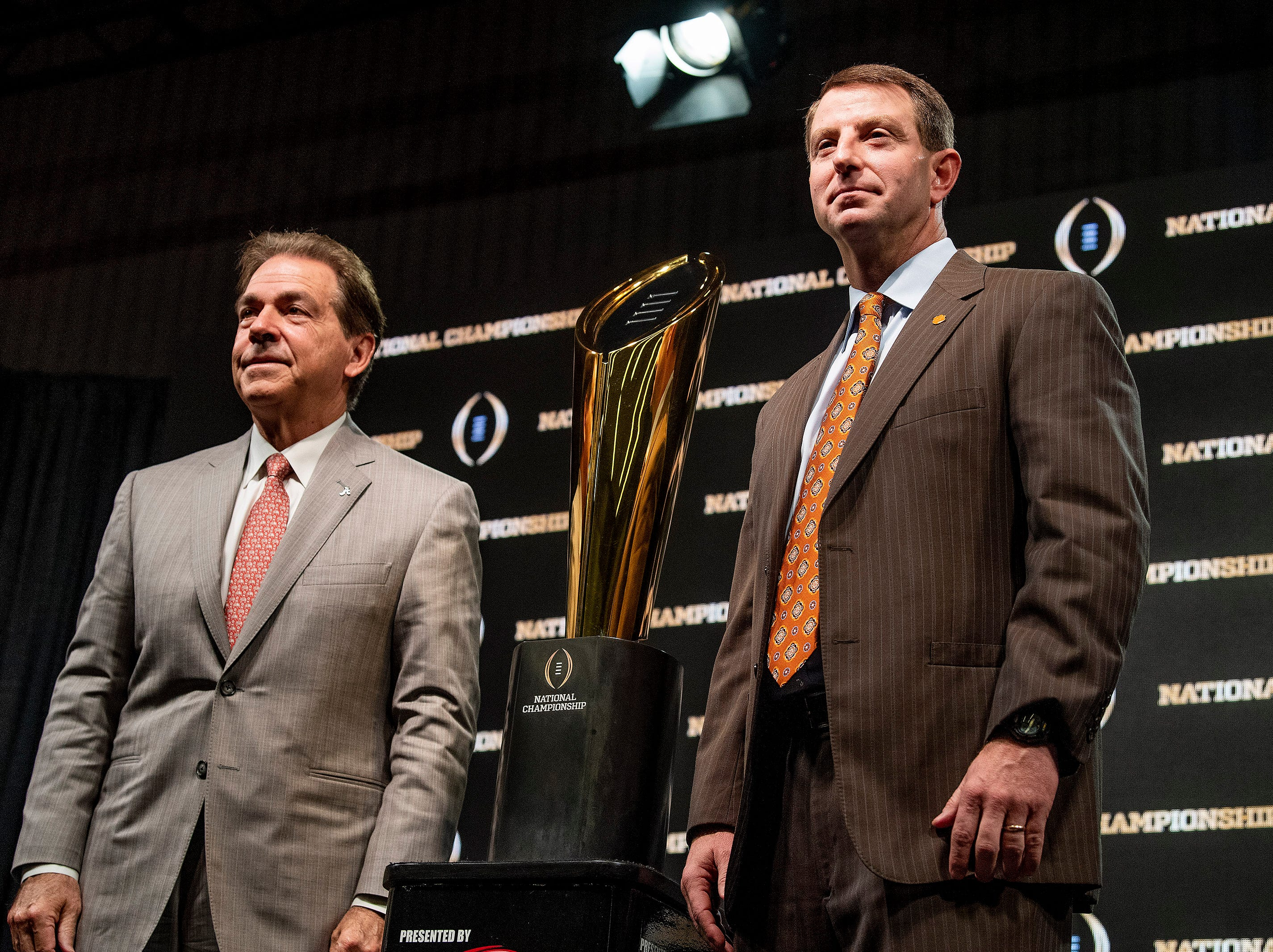 Alabama head coach Nick Saban and Clemson head coach Dabo Swinney pose with the National Championship trophy during the College Football National Championship coaches press conference in San Jose, Ca., on Sunday January 6, 2019.