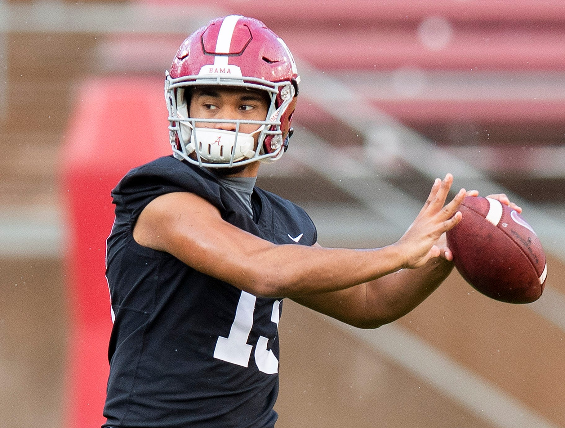 Alabama quarterback Tua Tagovailoa (13) passes as Alabama practices on the Stanford campus in Stanford, Ca., on Saturday January 5, 2019.