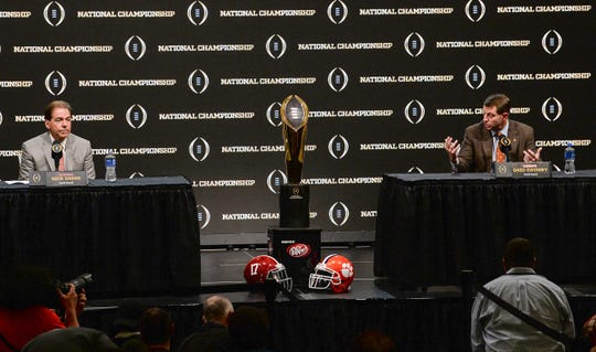 Alabama coach Nick Saban, left, listens while Clemson Head Coach Dabo Swinney speaks during the College Football Playoff Championship coaches press conference in San Jose, California January 6, 2019.