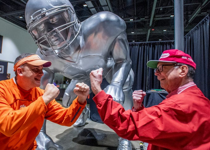 Clemson fan Glen Adair, left, and his Alabama fan father Charles Edgar pose together at Playoff Fan Central at the College Football National Championship in San Jose, Ca., on Sunday January 6, 2019.