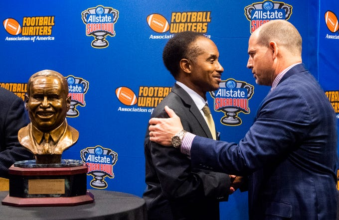 UAB football coach Bill Clark shakes hands with Eddie Robinson, III, as he is presented the Eddie Robinson Coach of the Year Award during a ceremony in San Jose, Ca., on Saturday January 5, 2019.