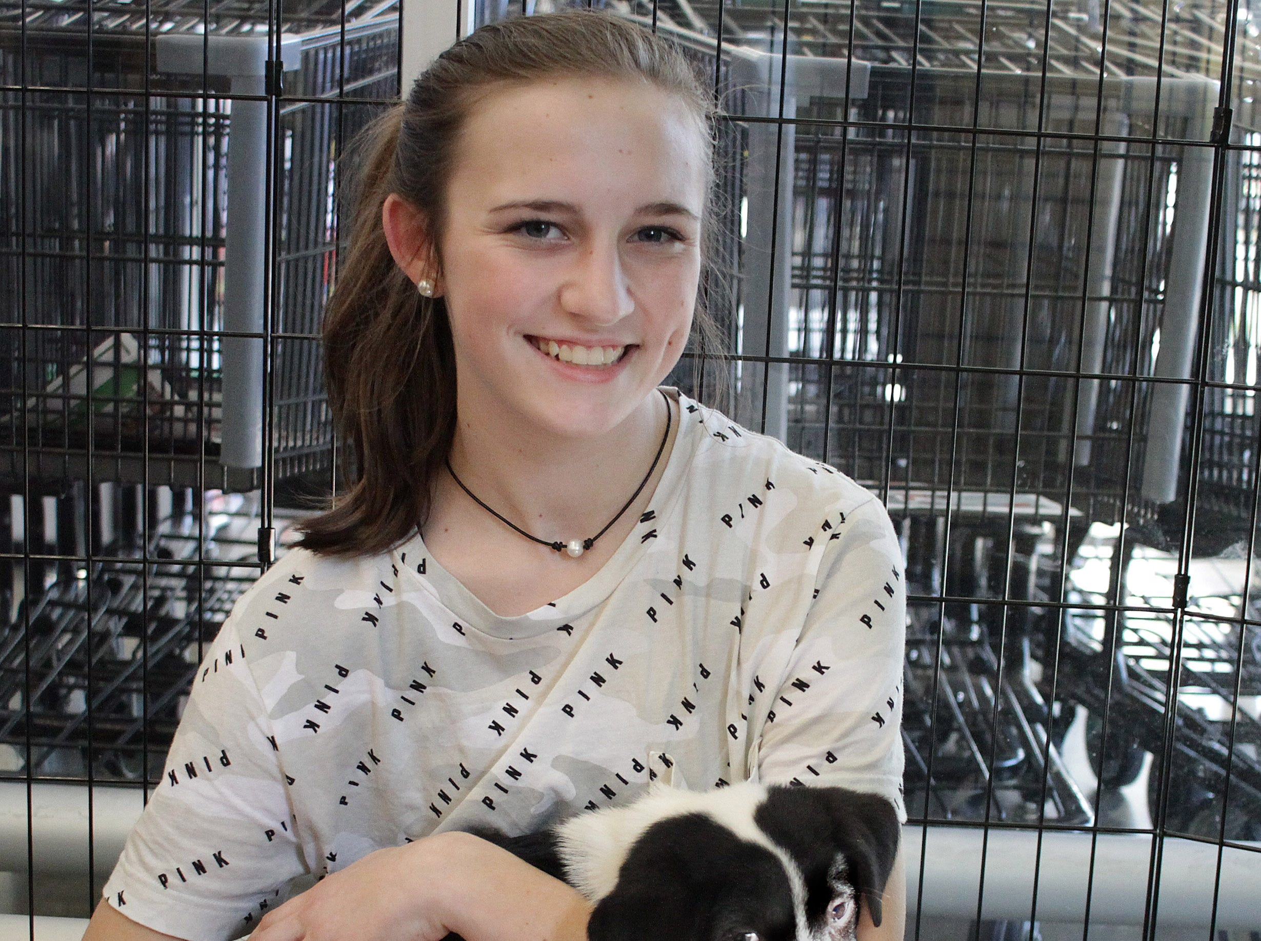 Paige Pardoe (13) holds a puppy at Jojo's Doghouse adoption event at Pet Supplies Plus in Hendersonville. TN on Saturday, January 5, 2019.