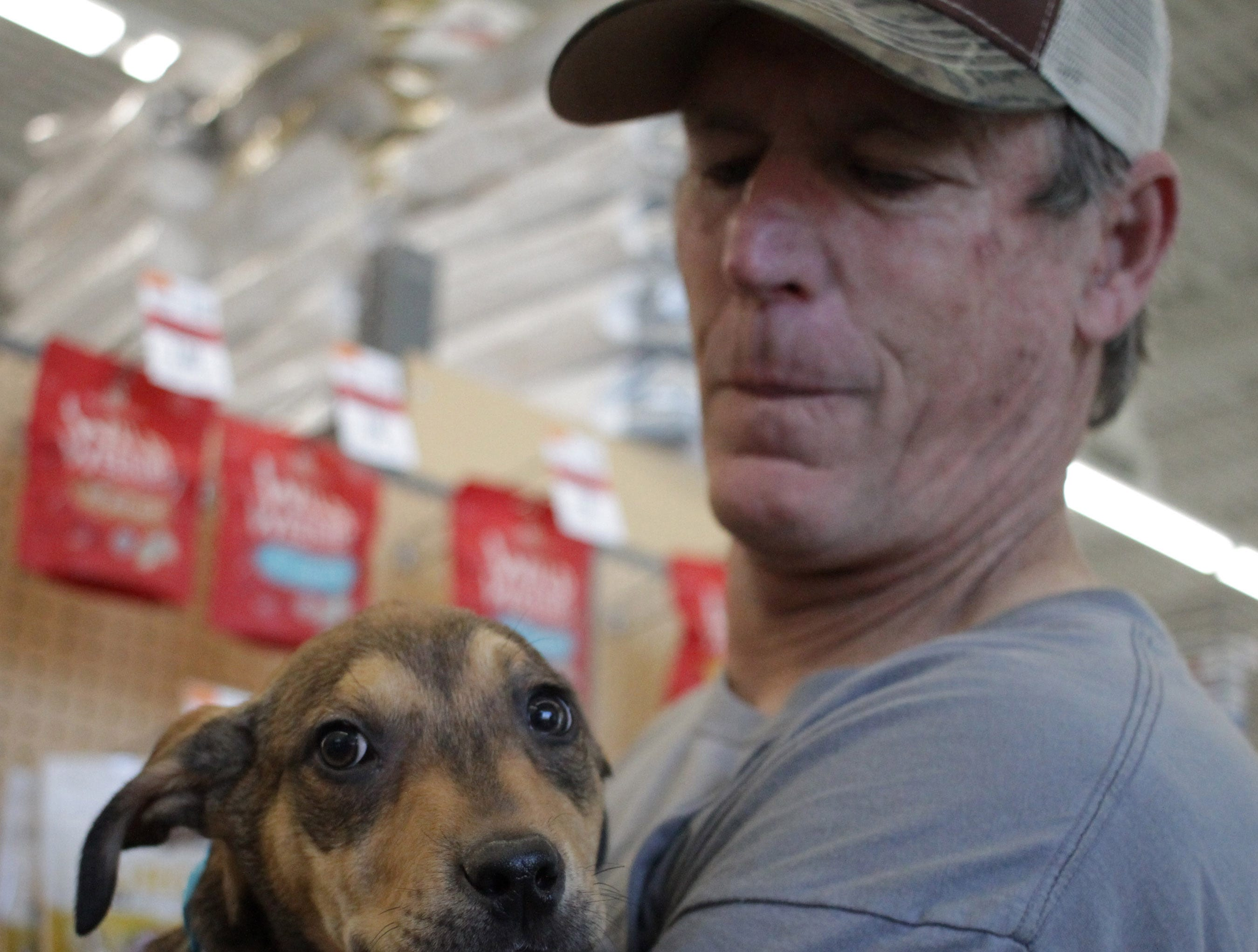Mark Stalling holds a puppy at Jojo's Doghouse adoption event at Pet Supplies Plus in Hendersonville, TN on Saturday, January 5, 2019.