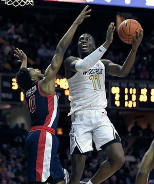 Vanderbilt forward Simisola Shittu (11) scores against Mississippi guard Blake Hinson (0) during the second half at Memorial Gym in Nashville on Saturday, Jan. 5, 2019.