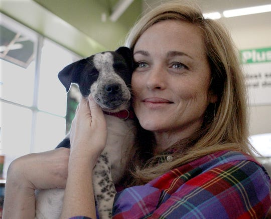 A woman seems to have found puppy love at Jojo's Doghouse Adoption event at Pet Supplies Plus in Hendersonville, TN on Saturday, January 5, 2019.