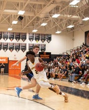 American Heritage's Zaire Wade, the son of Heat star Dwyane Wade, drives against Community School's Jacob Siegel during the Don Stewart Shootout at Lely High School on Saturday, Jan. 5, 2019.Heritage won, 71-68.