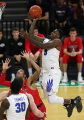 FGCU's RaySean Scott Jr. scores against Liberty on Saturday, Jan. 5, 2019, at Alico Arena in Fort Myers. Liberty beat FGCU 81-63.
