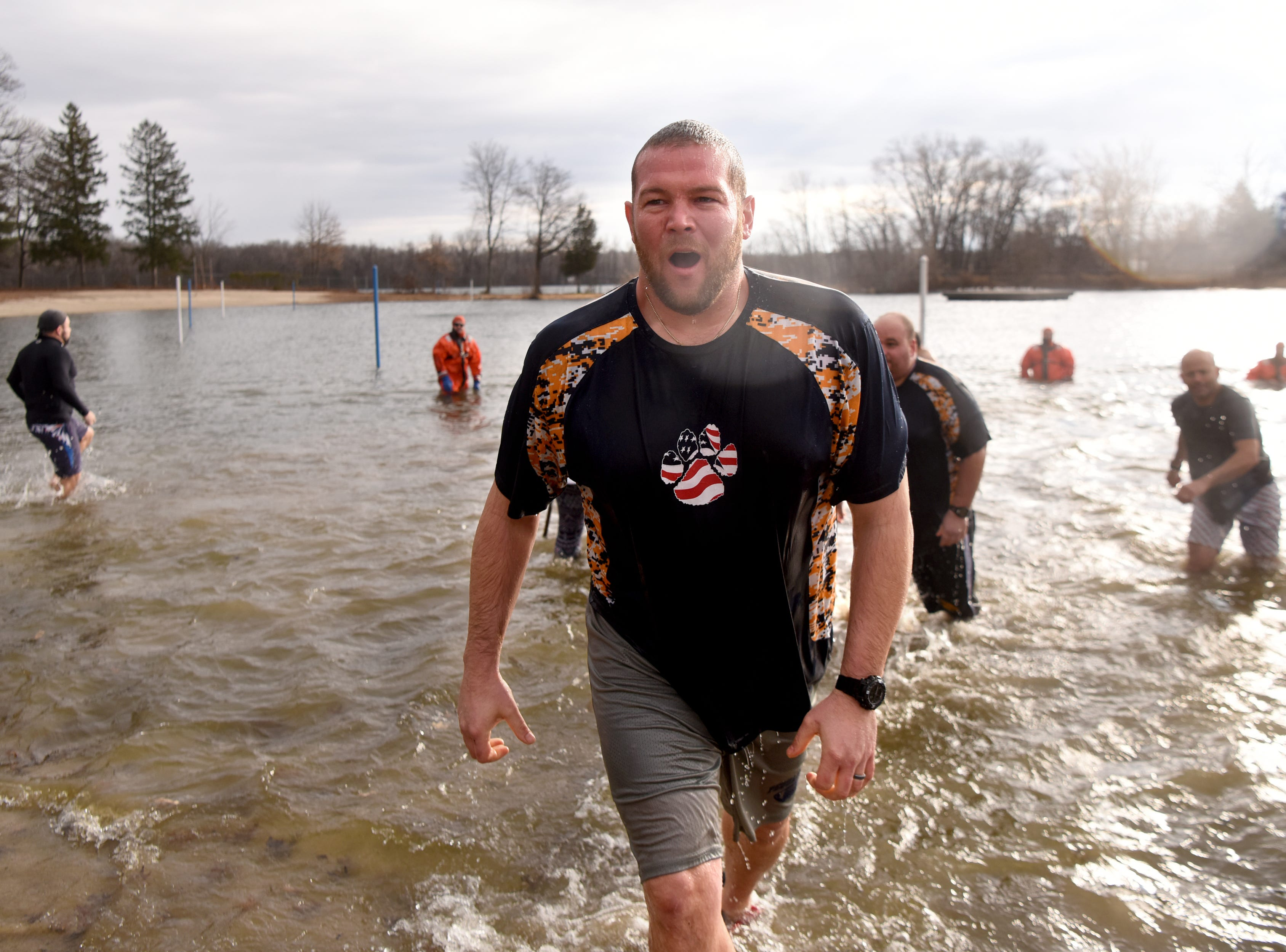 Luke Sica calmly walks out of the lake while participating in the 4th annual Pequannock Polar Plunge in Pequannock Valley Park on Sunday, January 6, 2019.