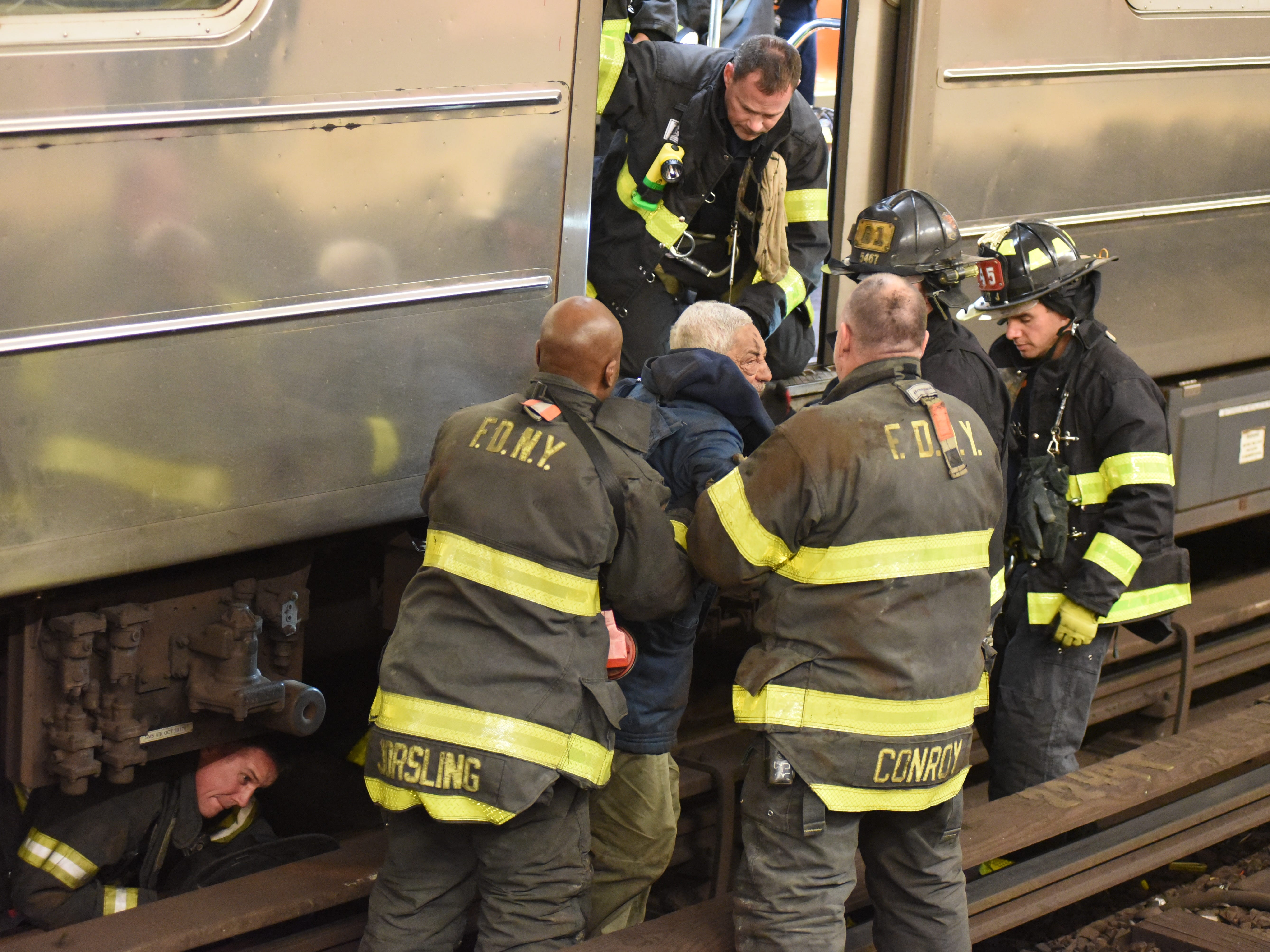 The scene where a man became trapped under a northbound 1 subway train at the W181st Street station in New York, NY  around 10:30 p.m. on Jan. 4, 2019. The man was rescued by firefighters and appeared to be uninjured after being in the space between the subway tracks.