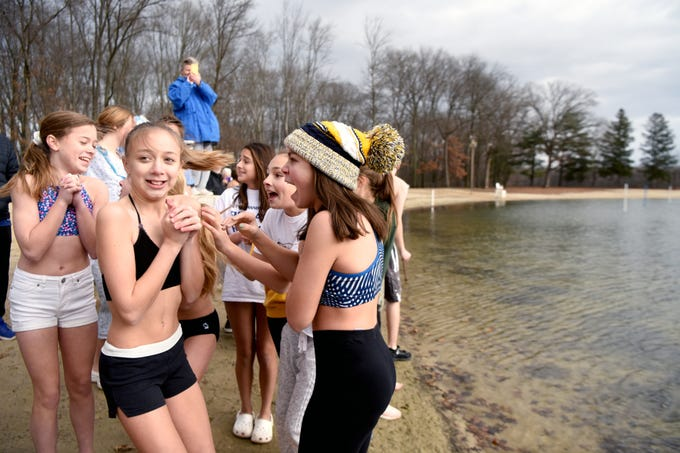 Participants in the 4th annual Pequannock Polar Plunge shiver waiting to run into the lake in Pequannock Valley Park on Sunday, January 6, 2019.