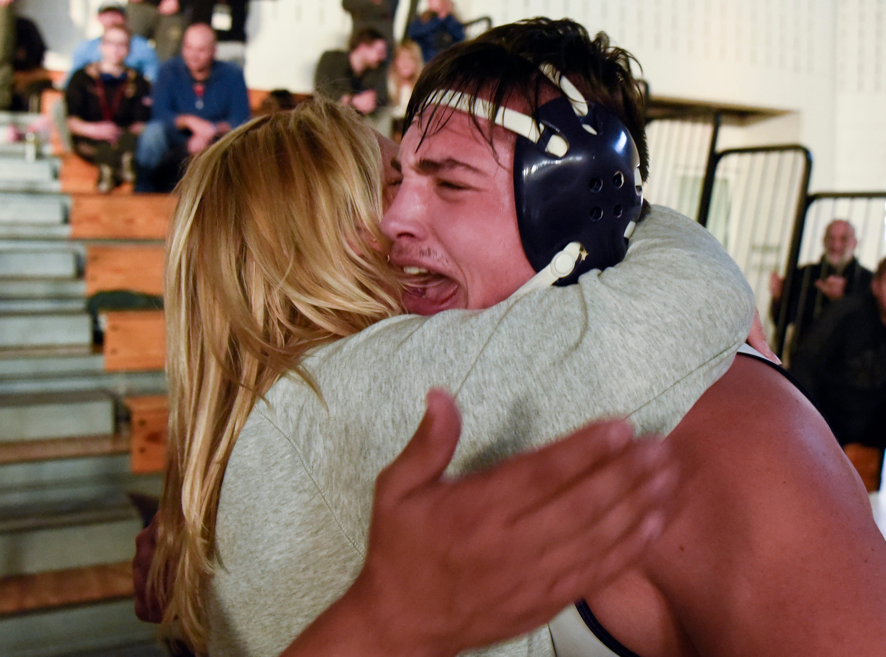 Michael Filieri of Garfield, right, hugs his mom Frances Filieri after winning the 220-pound title at the Sam Cali Battle for the Belt final on Sunday, Jan. 6, 2019, in West Orange.