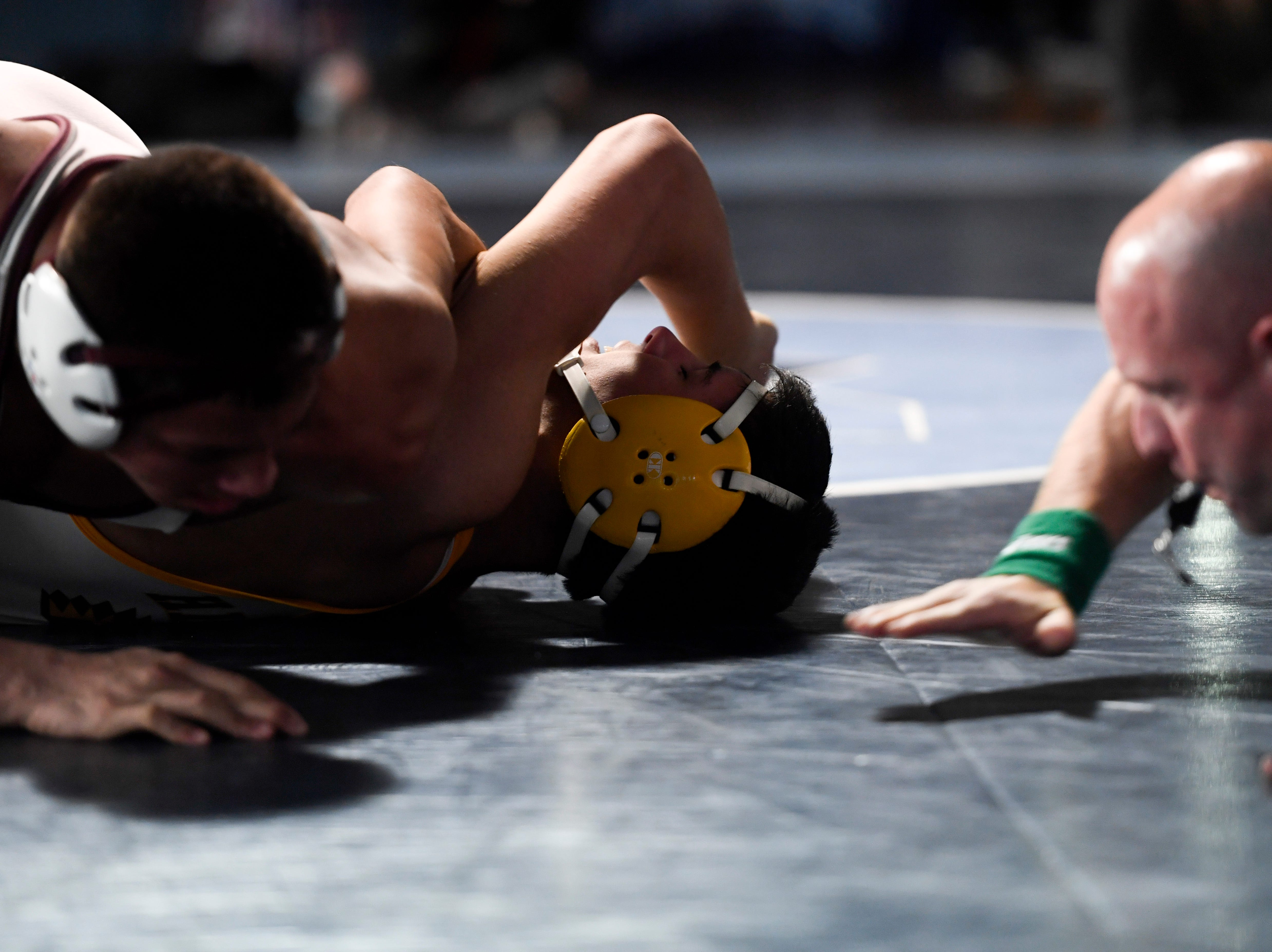 James Cruz of St. Peter's Prep, left, pins Vincent Mattaliano of Watchung Hills for the 170-pound title during the Sam Cali Battle for the Belt tournament on Sunday, Jan. 6, 2019, in West Orange.