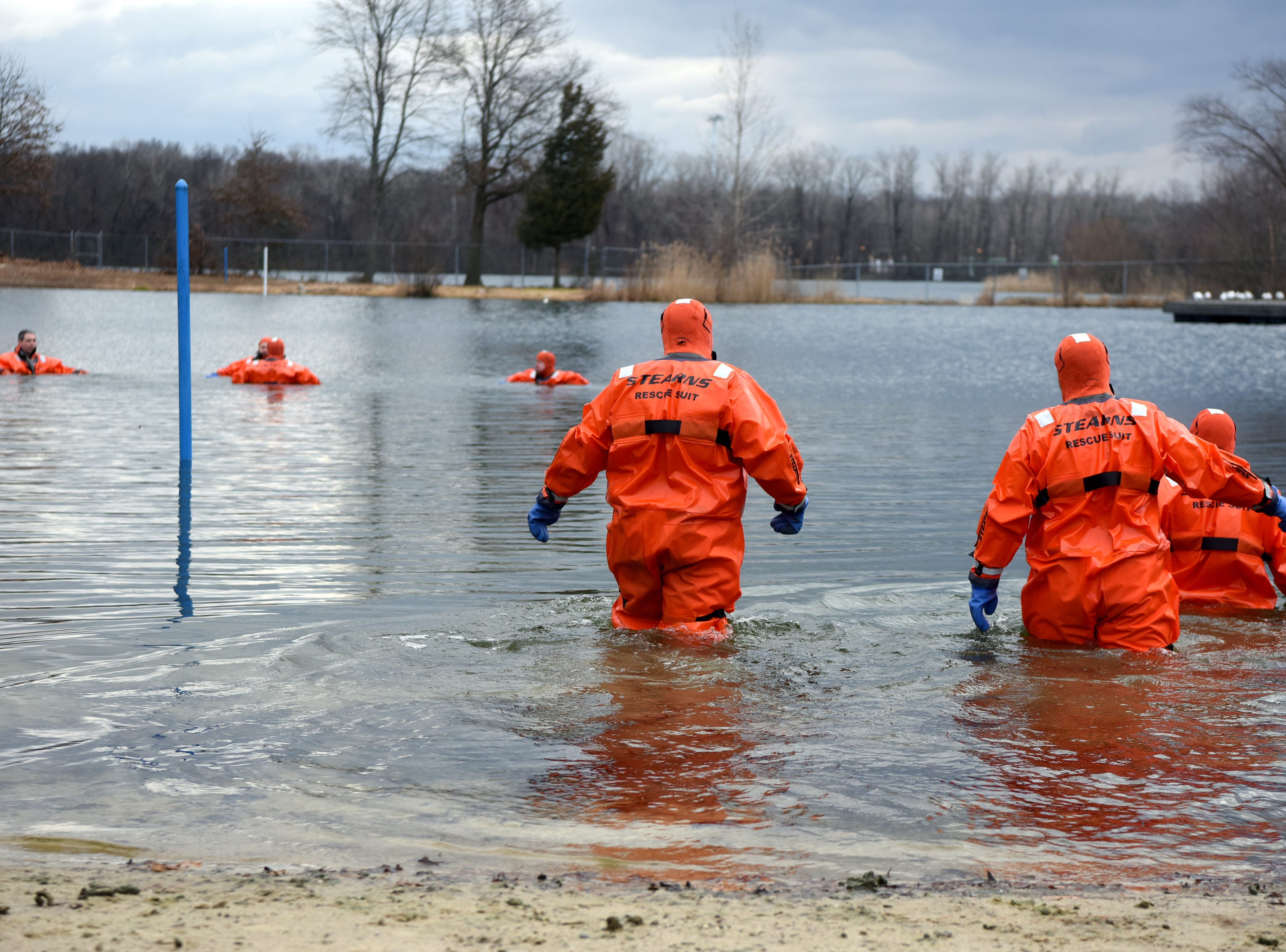 The 4th annual Pequannock Polar Plunge was held at the lake in Pequannock Valley Park on Sunday, January 6, 2019. Members of Pequannock Fire Department Engine Company One enter the water as a safety measure.