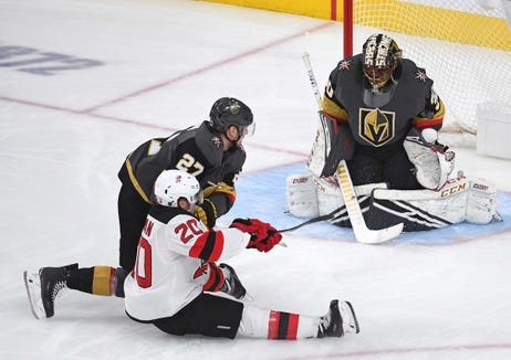 Jan 6, 2019; Las Vegas, NV, USA; New Jersey Devils center Blake Coleman (20) takes a shot on Vegas Golden Knights goaltender Malcolm Subban (30) as he is taken down by Vegas Golden Knights defenseman Shea Theodore (27) during the first period at T-Mobile Arena.