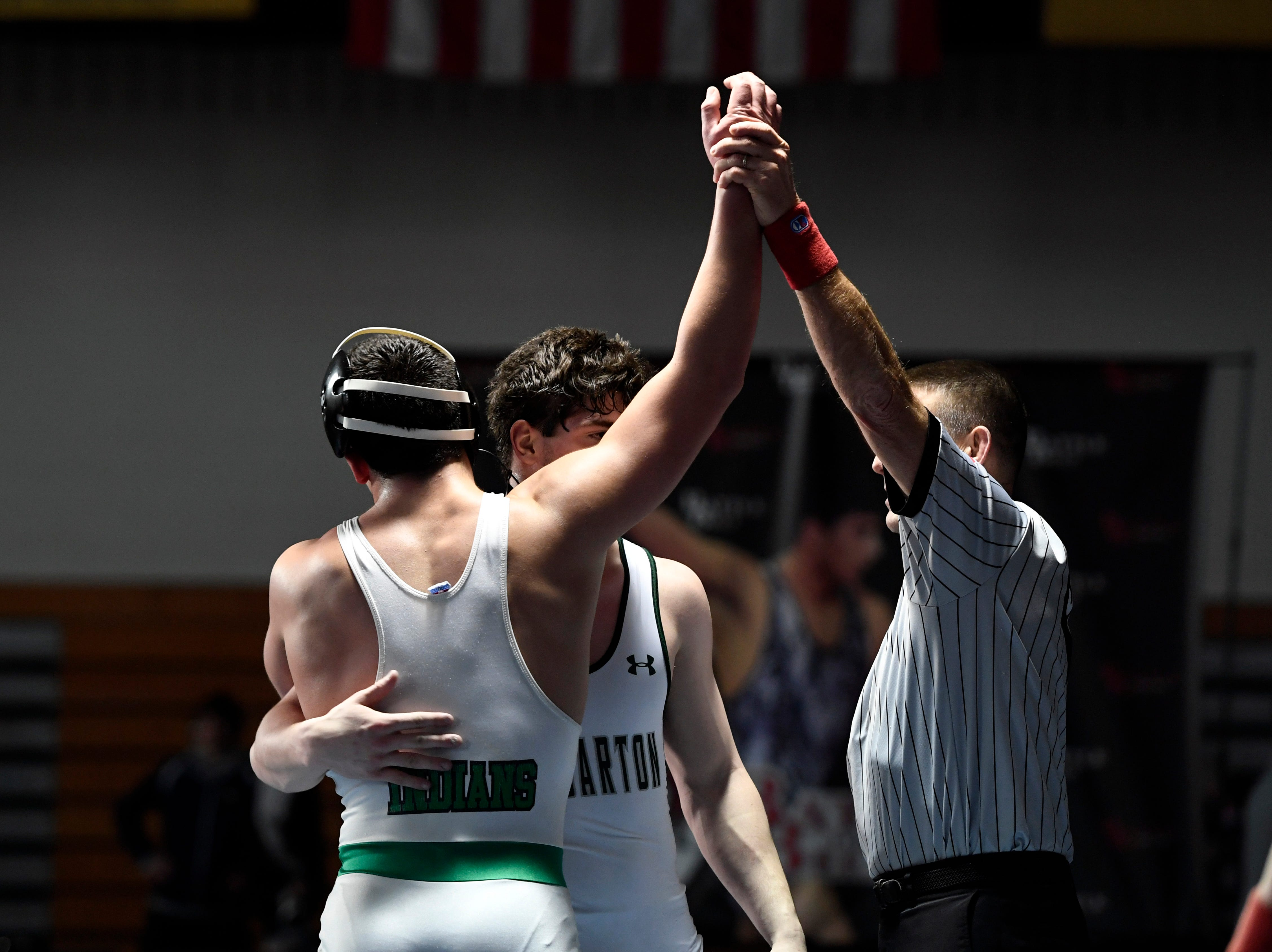 Tommy Chiellini of Pascack Valley, left, wins the 182-pound final as him and Kieran Calvetti of Delbarton hug during the Sam Cali Battle for the Belt final on Sunday, Jan. 6, 2019, in West Orange.