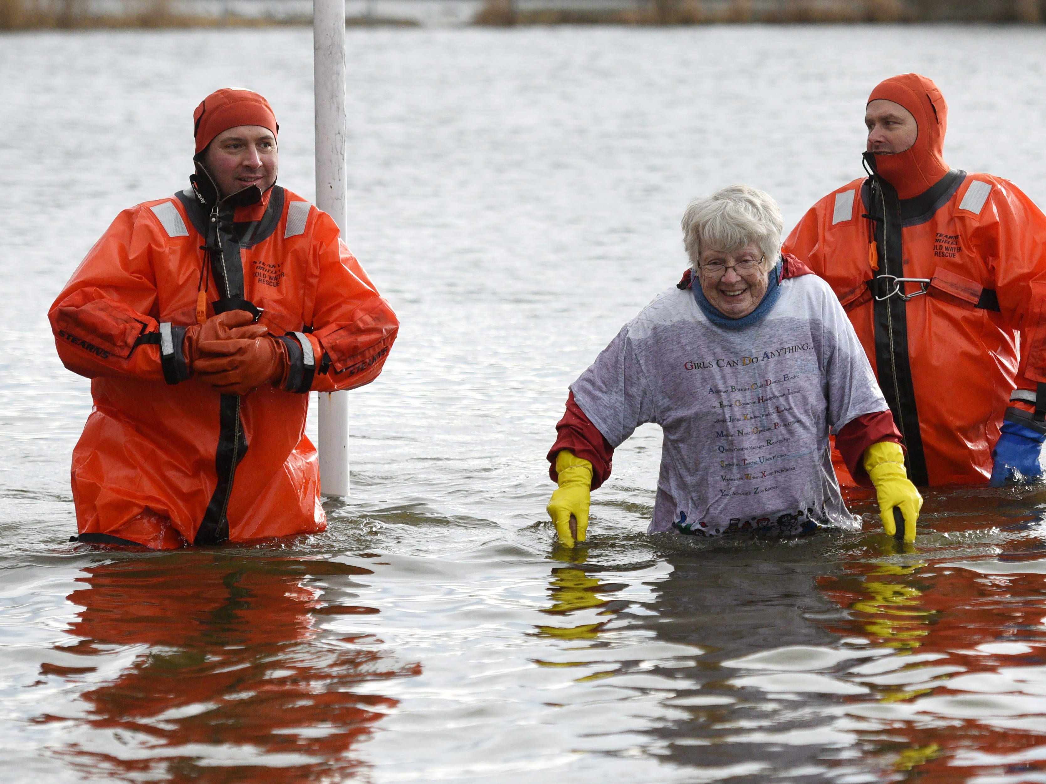 Kay Collins, 82, the oldest participant in the 4th annual Pequannock Polar Plunge, also went the deepest into the lake at Pequannock Valley Park on Sunday, January 6, 2019. Collins circled the pole before dunking into the lake three times.