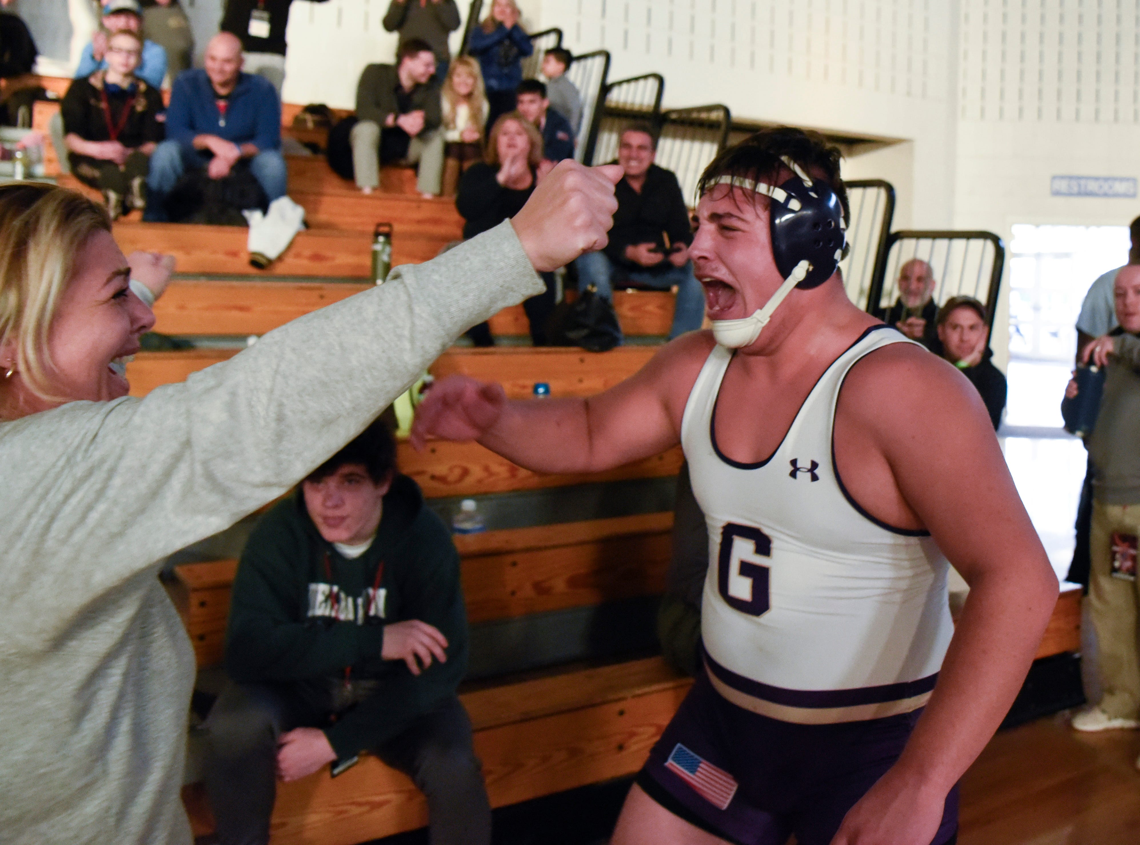 Michael Filieri of Garfield, right, celebrates his win with his mom Frances Filieri for the 220-pound title at the Sam Cali Battle for the Belt final on Sunday, Jan. 6, 2019, in West Orange.