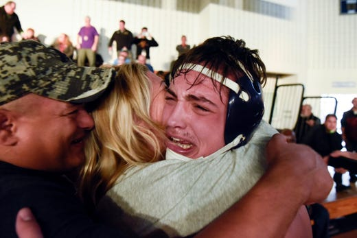 Michael Filieri of Garfield, right, celebrates with family after winning the 220-pound title at the Sam Cali Battle for the Belt final on Sunday, Jan. 6, 2019, in West Orange.