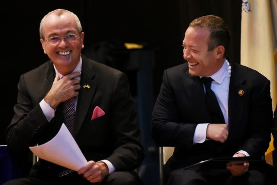 Governor Phil Murphy and Congressman Josh Gottheimer share a laugh during the Dumont reorganization meeting in Dumont on Saturday January 5, 2019.