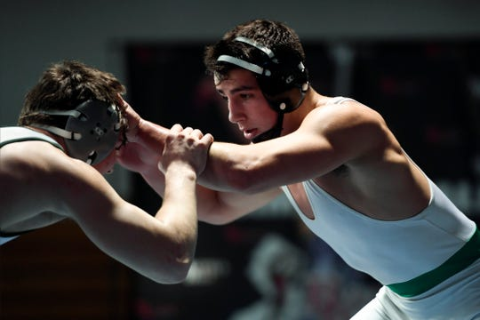Tommy Chiellini of Pascack Valley, right, won his 182-pound final against Kieran Calvetti of Delbarton, left, during the Sam Cali Battle for the Belt tournament on Sunday, Jan. 6, 2019, in West Orange.