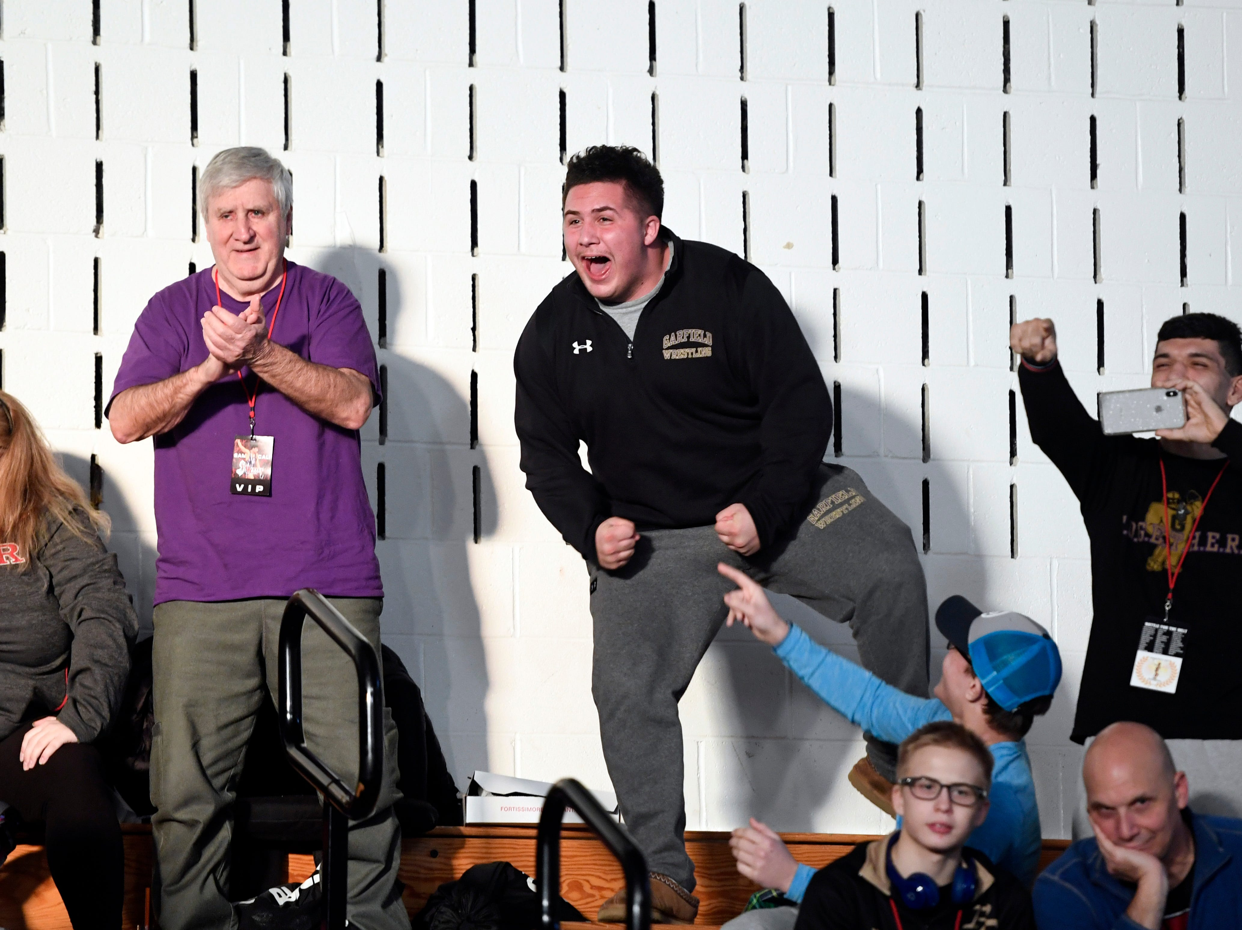 Fans cheer on Garfield's Michael Filieri (not pictured) as he wins his 220-pound final during the Sam Cali Battle for the Belt final on Sunday, Jan. 6, 2019, in West Orange.
