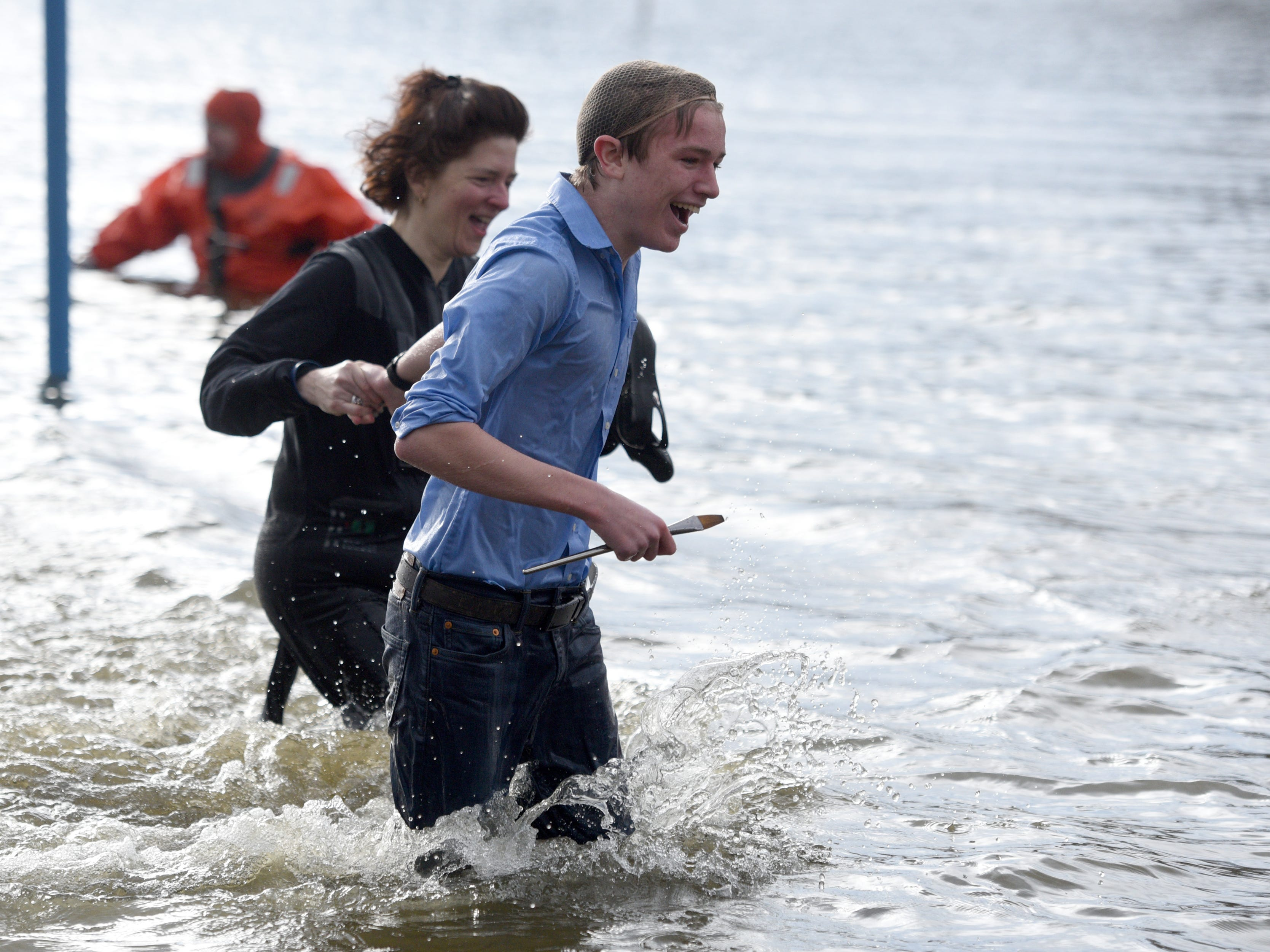 Participants in the 4th annual Pequannock Polar Plunge run out of the lake in Pequannock Valley Park on Sunday, January 6, 2019.