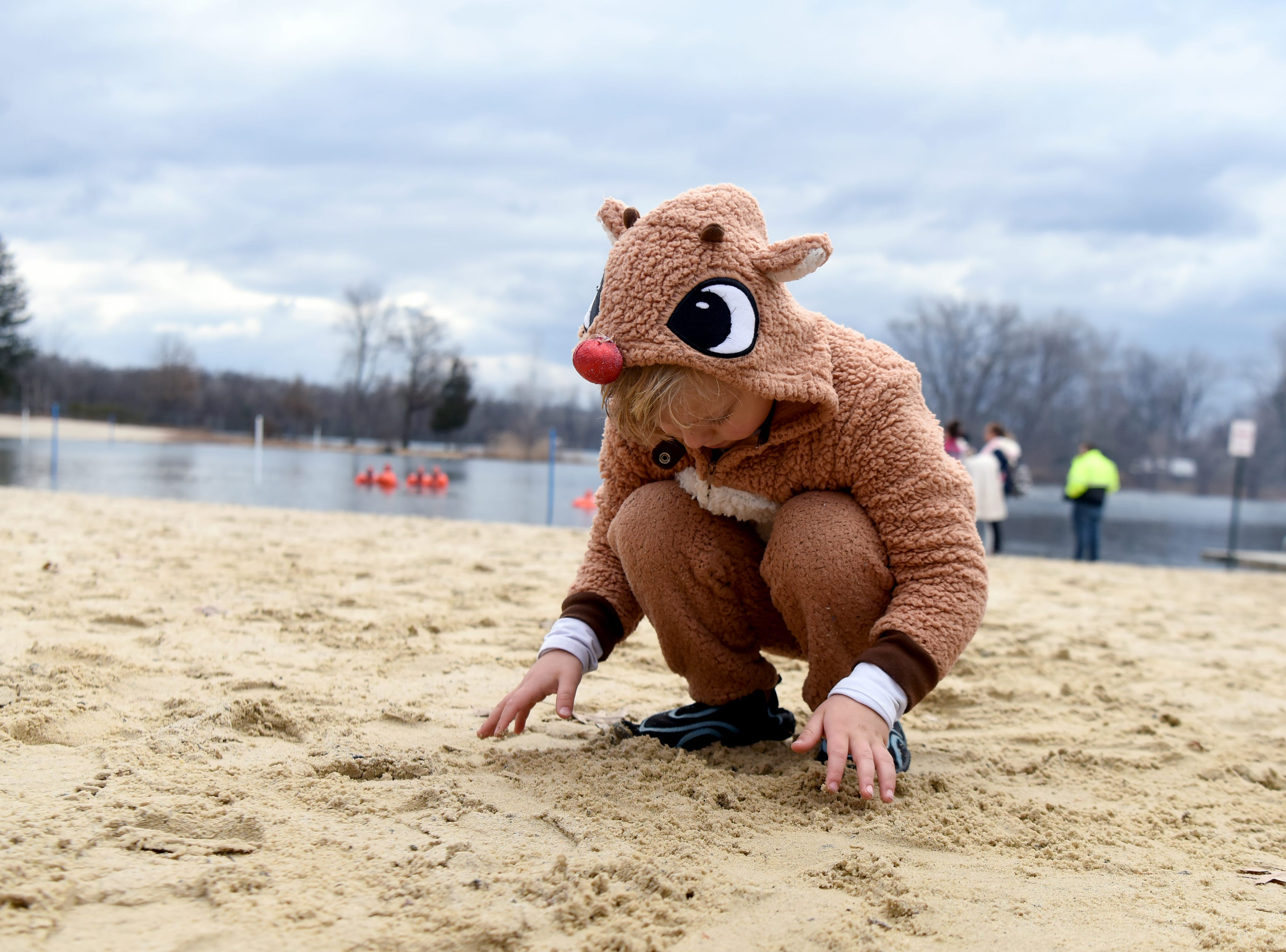 James Gronda, 3, plays in the sand before participating in the 4th annual Pequannock Polar Plunge at Pequannock Valley Park on Sunday, January 6, 2019.