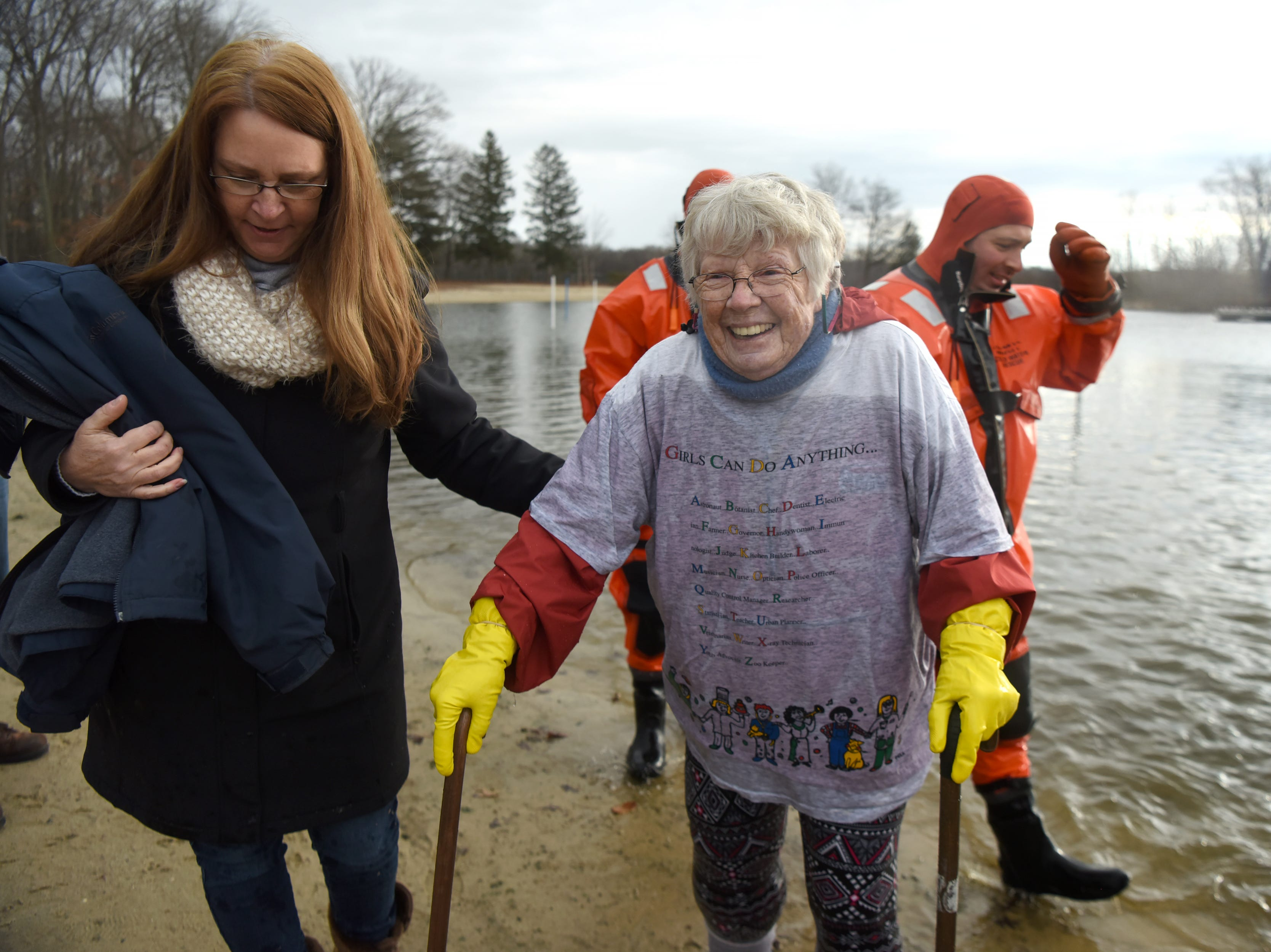 Michelle Mertrud helps her friend Kay Collins, 82, as Collins makes her way out of the lake during the 4th annual Pequannock Polar Plunge in Pequannock Valley Park on Sunday, January 6, 2019. Collins was the oldest participant at the event.