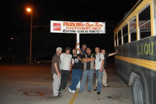 Members of the band Liquid Cheese — next to their tour bus — stop for a bite to eat at Chico's Tacos in El Paso.