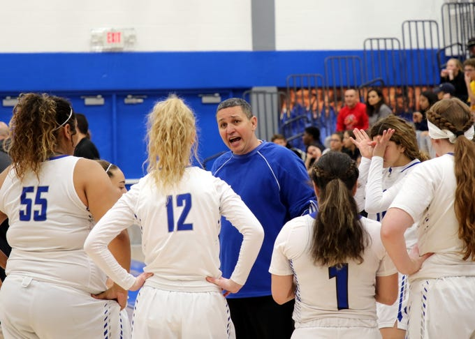 John Zumbrun talks to his Cavegirls during a timeout in Saturday's game against the Centennial Hawks. Carlsbad won, 48-32.