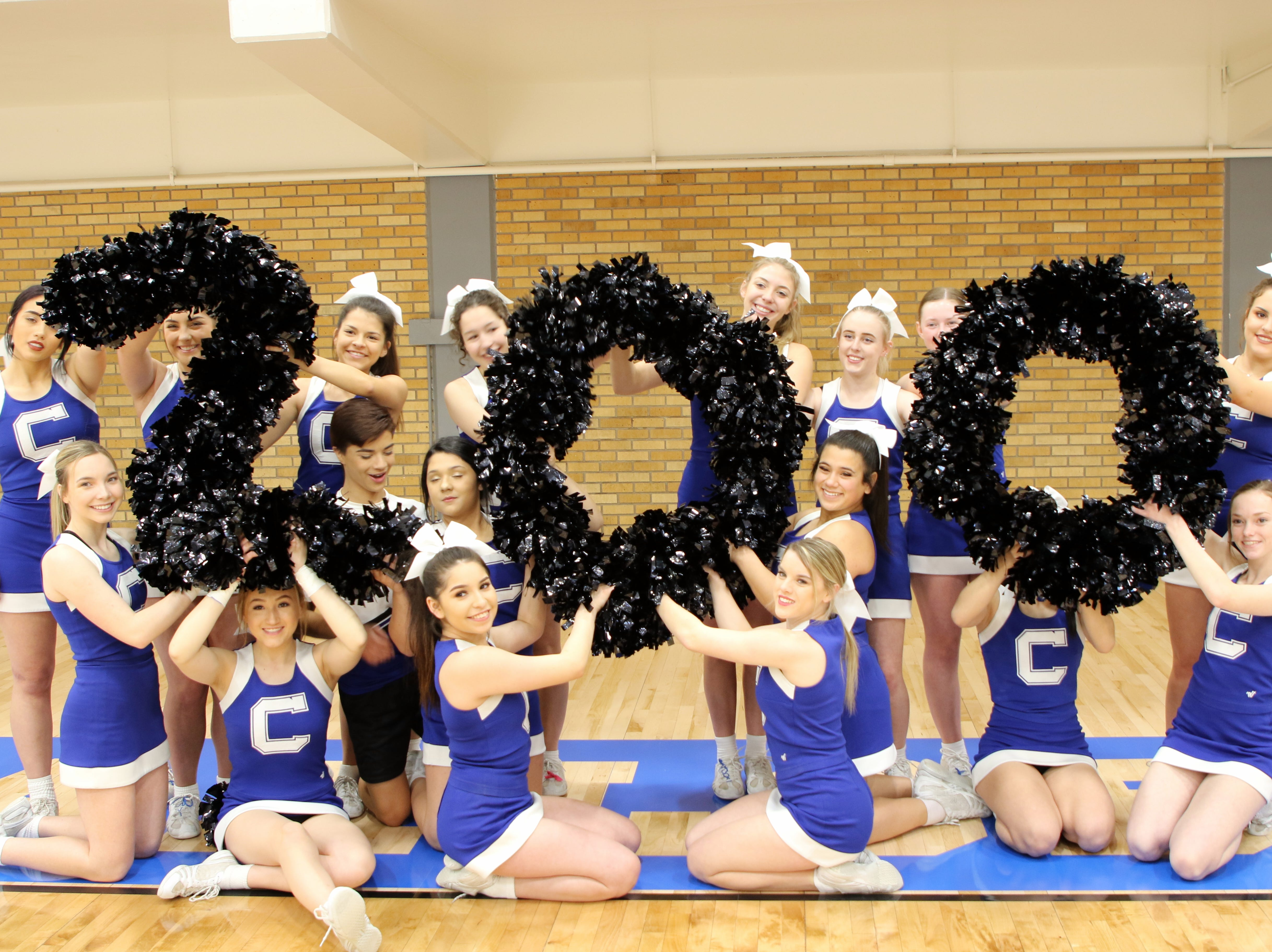 The Carlsbad cheerleaders display the number 200 to celebrate John Zumbrun's 200th win as the Cavegirls head coach. Carlsbad beat Centennial, 48-32.