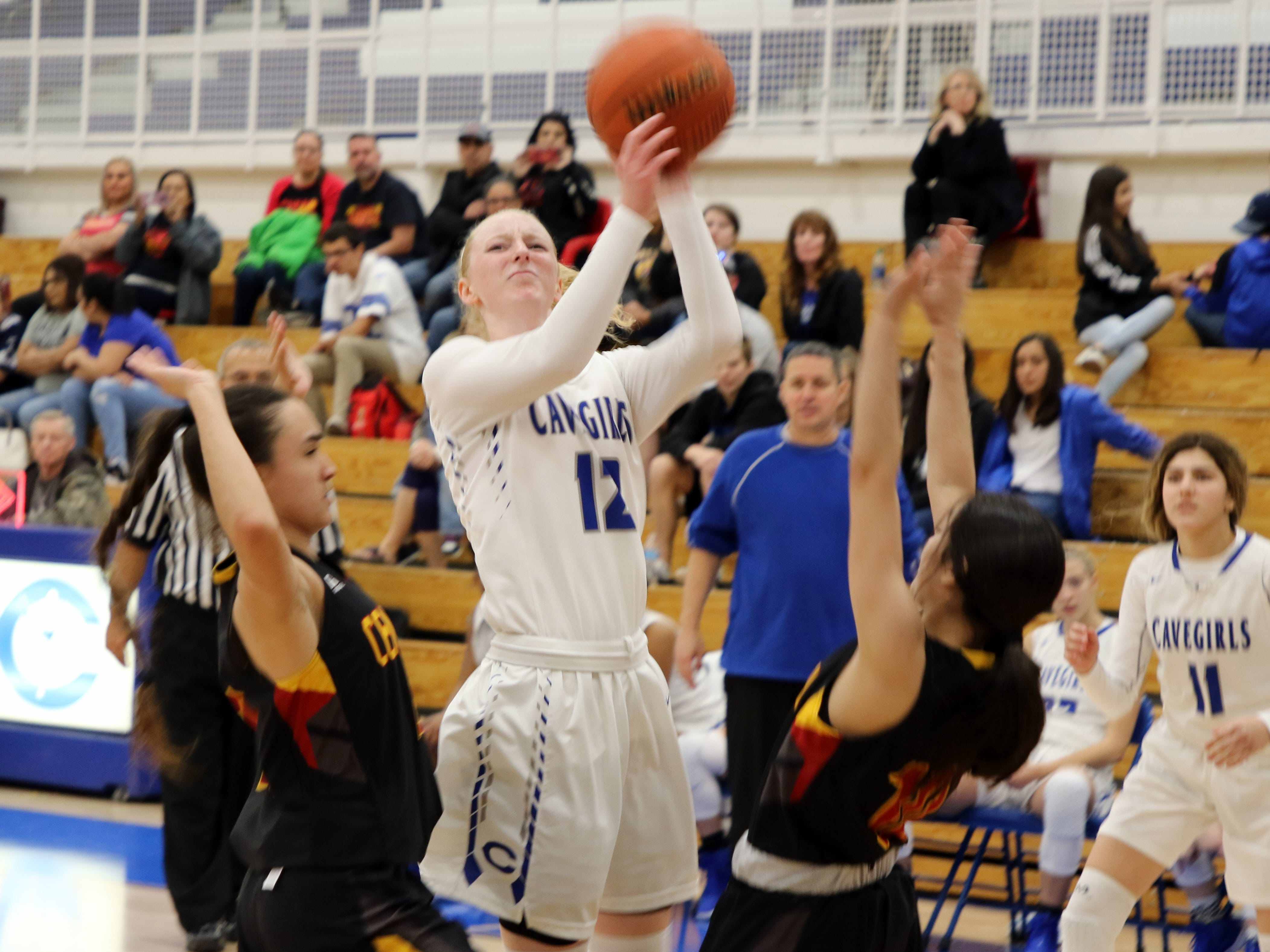 Carsyn Boswell drives the lane against Centennial on Saturday. She finished with 24 points.