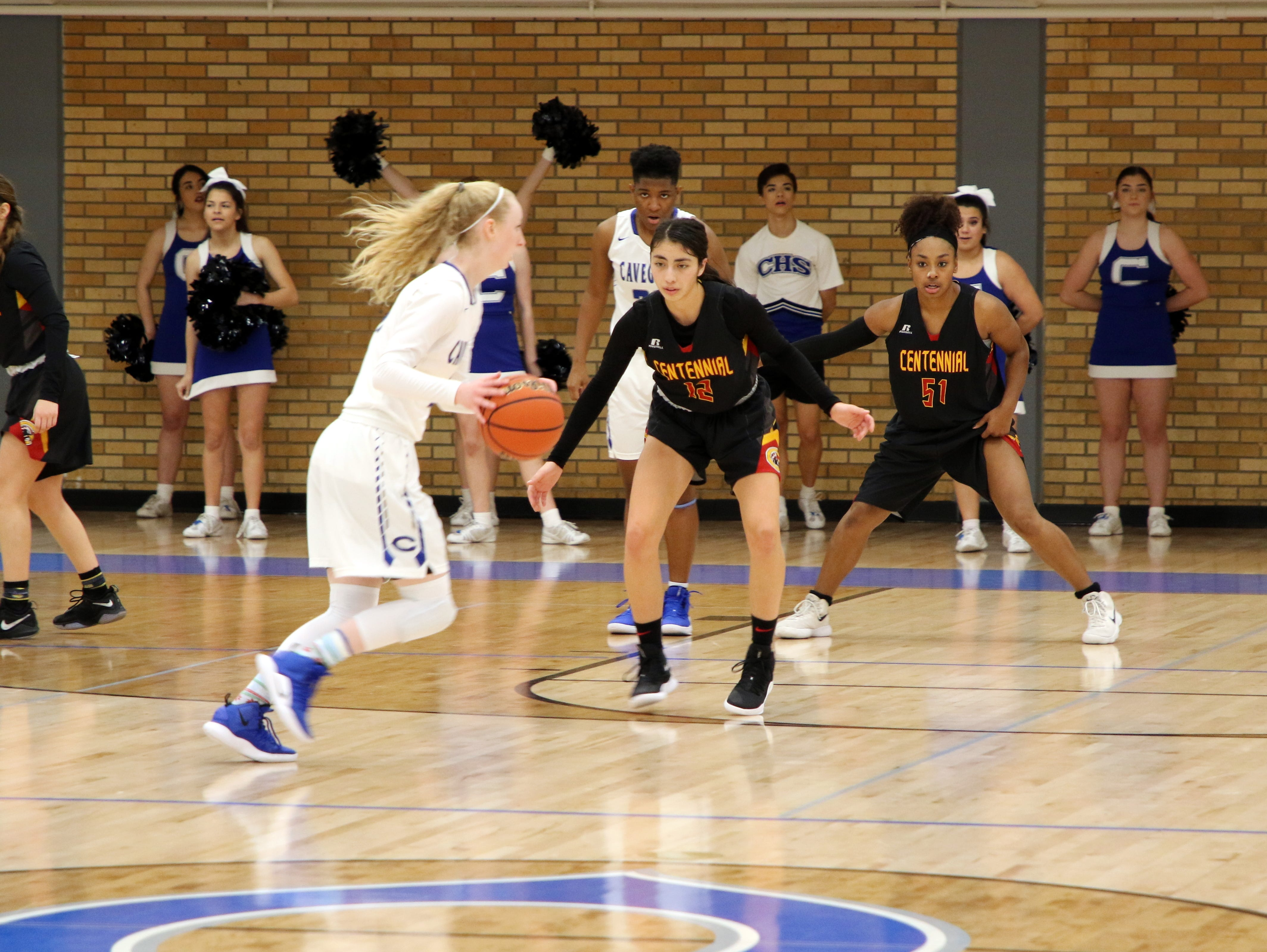 Carsyn Boswell is guarded by Centennial's Jessica Rios in the second half of Saturday's game.