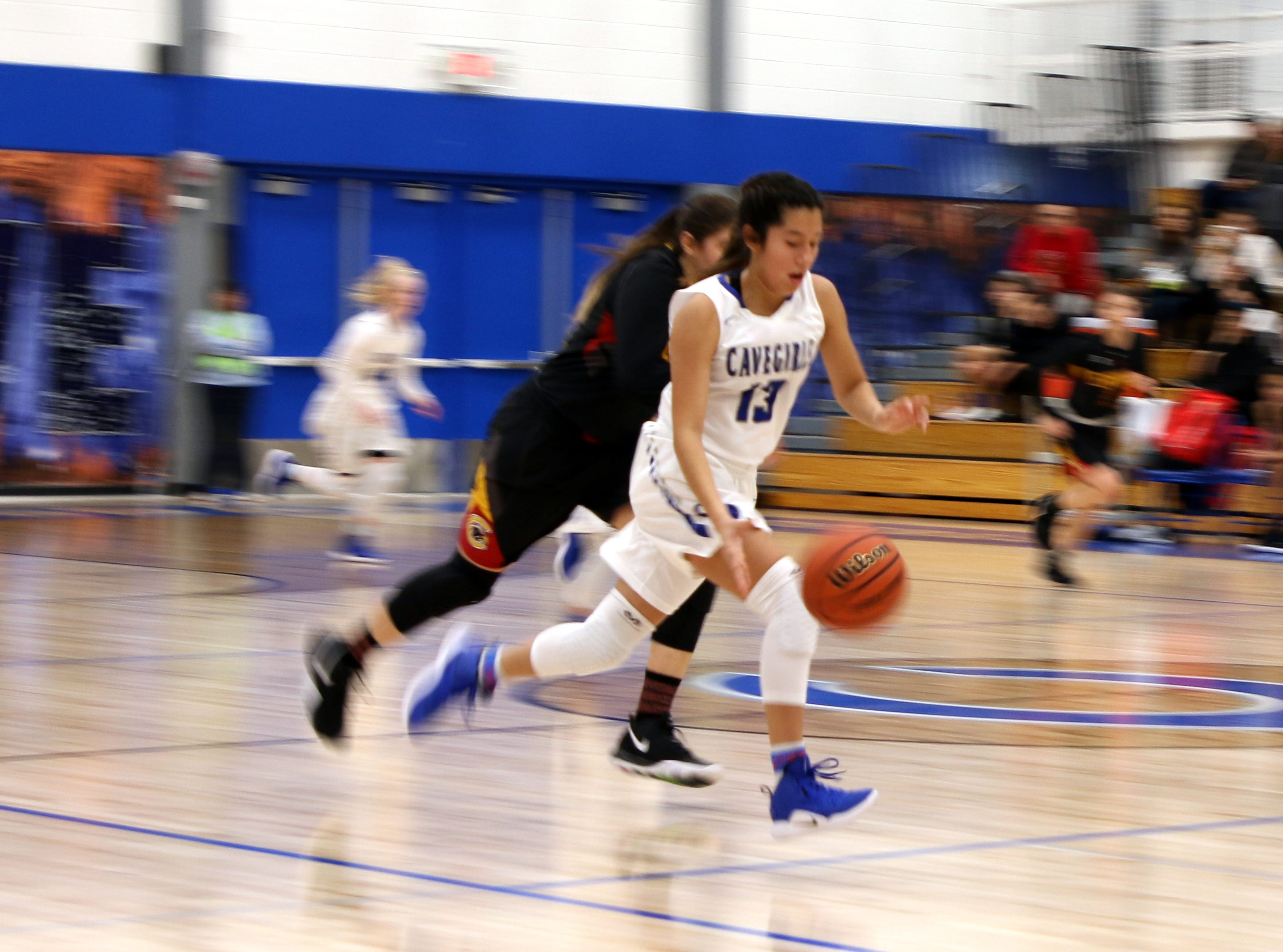 Carlsbad's Tori Flores starts a fastbreak during Saturday's game against the  Centennial Hawks. Carlsbad won, 48-32.