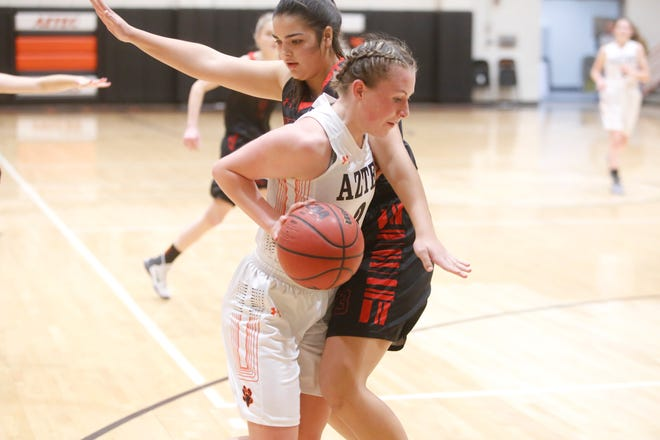 Aztec's Sierra Villanueva cuts along the baseline toward the basket against Durango's Sydney Flores during the Rumble in the Jungle championship game Saturday at Lillywhite Gym in Aztec.