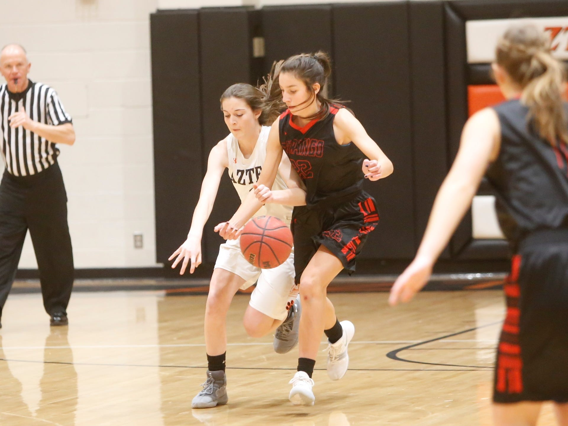 Durango's Maddy McManus swipes the ball away from Aztec's Daniella Sanders to force a turnover during the Rumble in the Jungle championship game Saturday at Lillywhite Gym in Aztec.